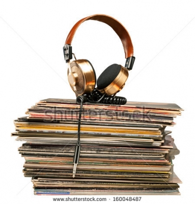 stock-photo-golden-headphones-lying-on-the-stack-of-vinyle-records-160048487.jpg