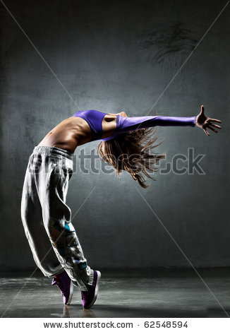 stock-photo-young-woman-dancer-on-wall-background-62548594.jpg