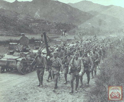 Japanese_soldiers_and_tanks_marching_towards_Sung-pu_and_Huang-an_beyond_Ta-pieh_Mountains.jpg