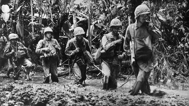 November 1943 A detachment of US Marines plough through knee-deep mud on their way to confront the Japanese on Bougainville Island in Papua New Guinea 28Small29